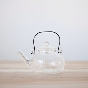 24 oz. -Kettle-Style Glass Teapot w/ Copper Handle: textured sides, stainless steel spiral filter & glass lid.